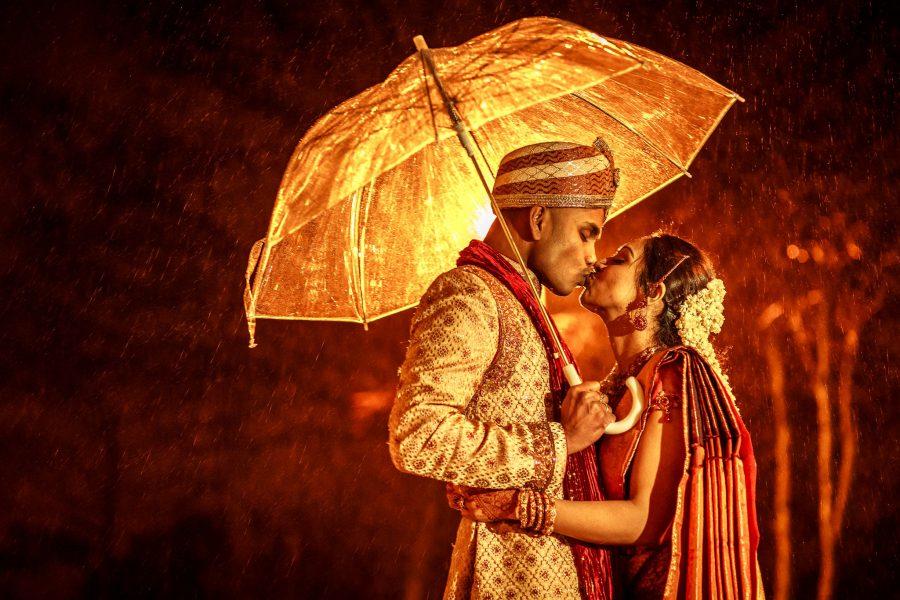 Newly weds under the umbrella