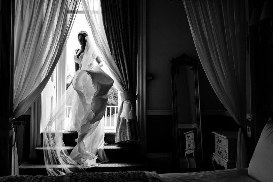 Bride showing off her dress