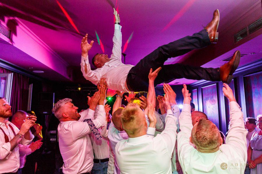 London Wedding Photographer Portfolio party groom in the air
