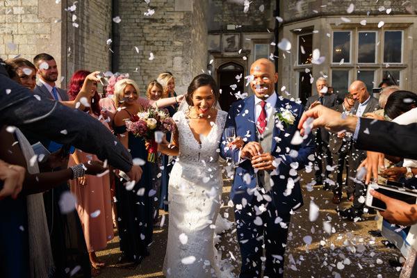 confetti shot afafterher the wedding ceremony