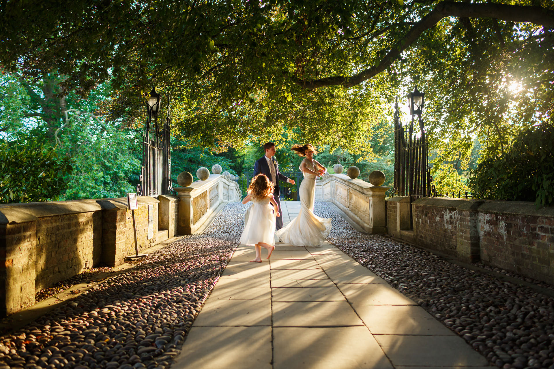 Documentary Wedding Photographer couple dancing on the bridge after their ceremony