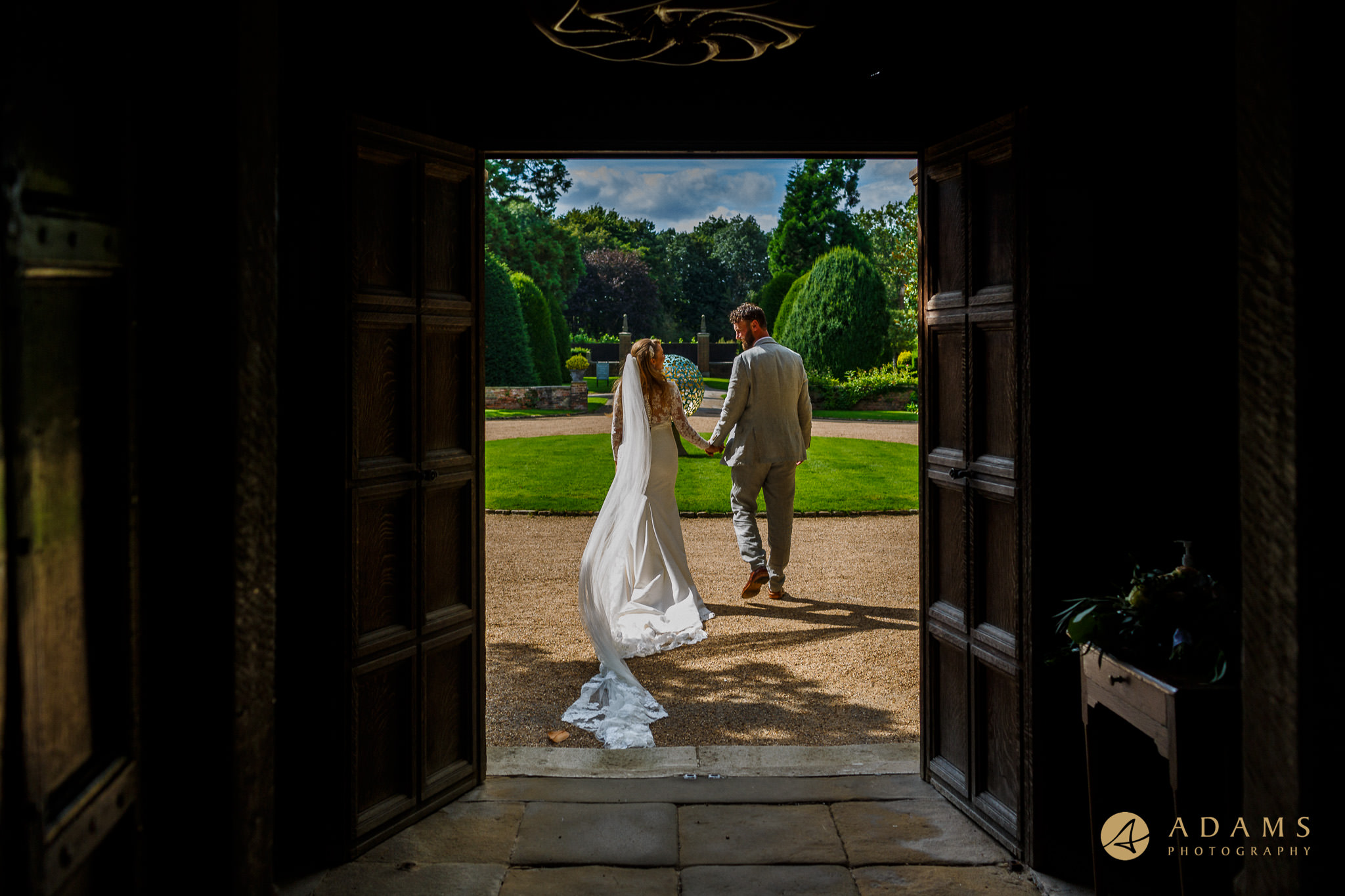 Married couple walking out of the door at Great Fosters Hotel